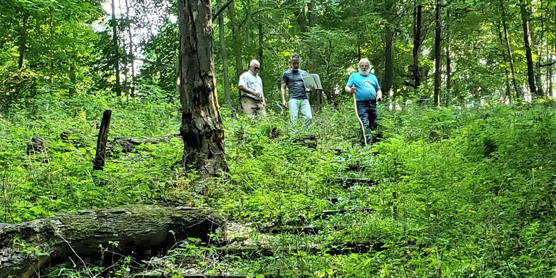 Project Partners Surveying Land at Camp Courageous
